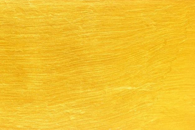 Tło złotej ściany luksusowy mozaikowy złoty brokat