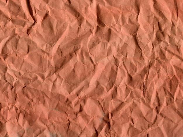 Tło zmięty papier w odcieniach brązu
