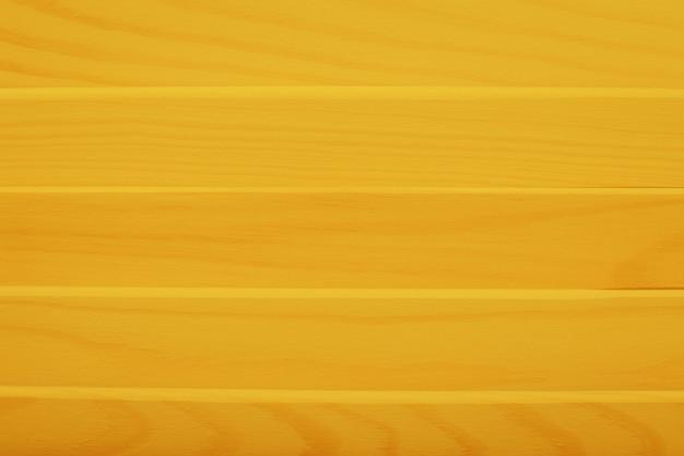 Tło żółte drewniane deski. naturalne drewniane tła na baner.