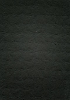 Tłoczone czarne tło tekstura papieru
