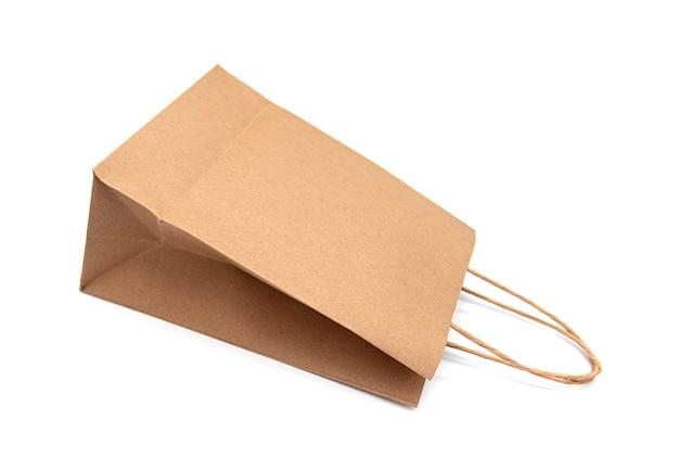 Torba papierowa, pusta torba, uchwyt na białym tle