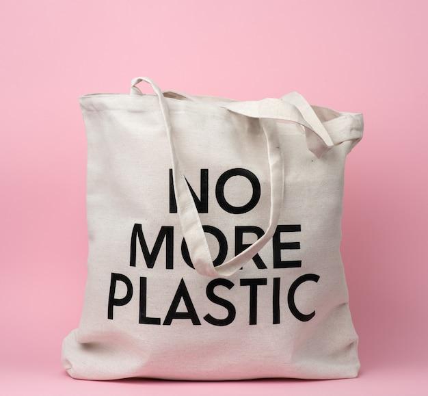 Torba tekstylna beżowa z napisem koniec z plastiku na różowym tle, bez plastiku