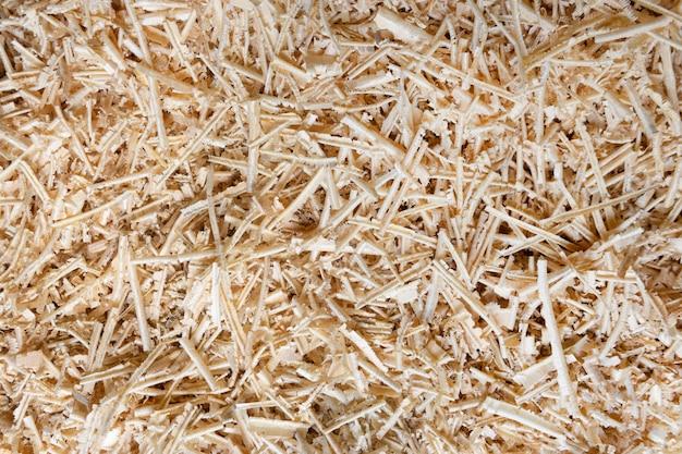 Trociny lub pyłu drzewnego tekstury tło, podłużne trociny po obróbce drewna