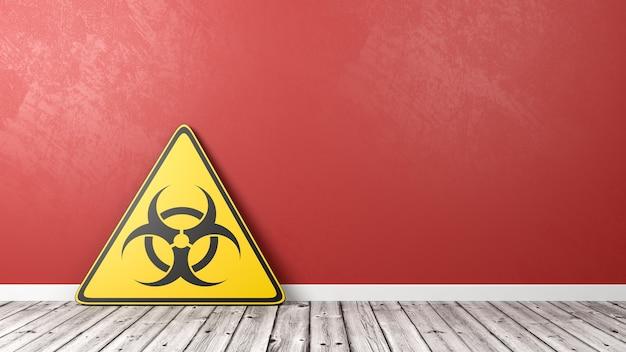 Trójkąt symbol epidemii na drewnianej podłodze przed ścianą