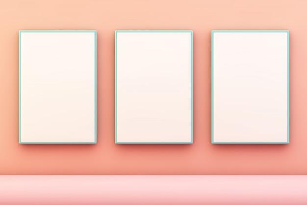 Trzy niebieskie ramki na różowej ścianie