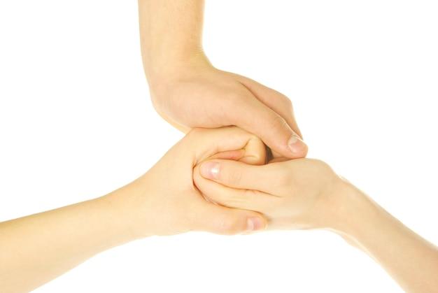 Trzy ręce razem na białym tle