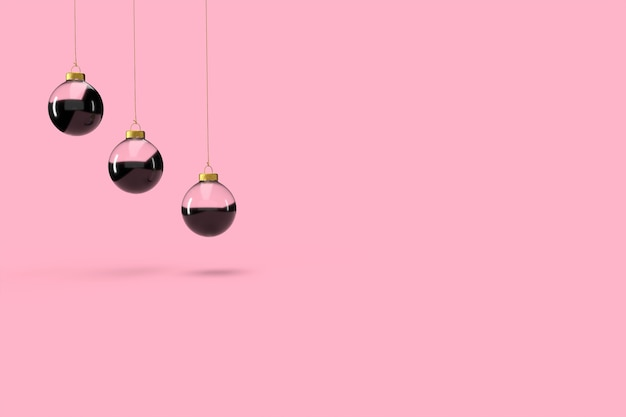 Trzy szklane bombki w minimalistycznej tapecie. wesołych świąt bożego narodzenia koncepcja