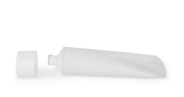 Tubka pasty do zębów lub kremu na białym tle