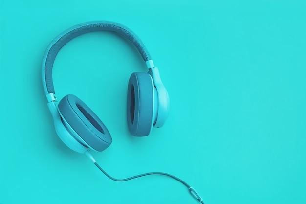 Turkusowe słuchawki na kolorowym tle