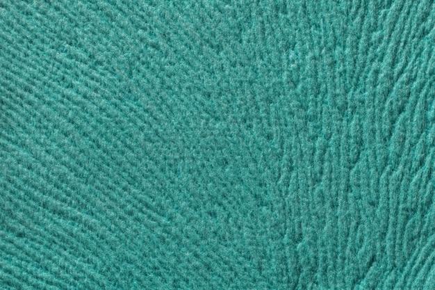 Turkusowy tło od wełnistej tkaniny