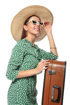 Turystka z bagażem na białym