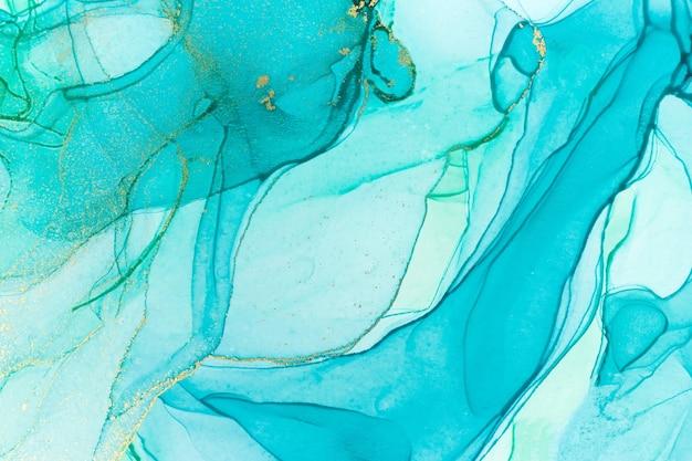 Tusz alkoholowy niebieski przezroczysty. akwarela krople tekstury w stylu oceanu.