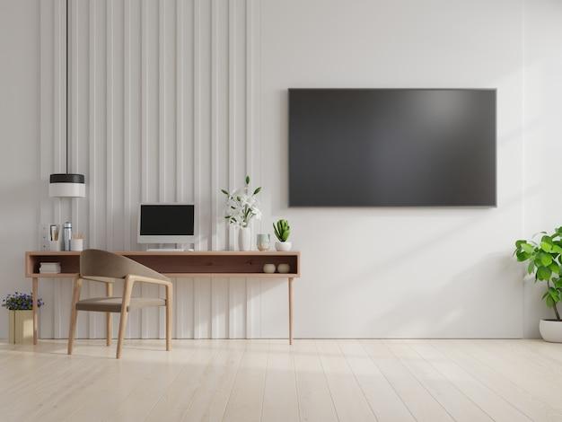 Tv na ścianie i szafka w salonie