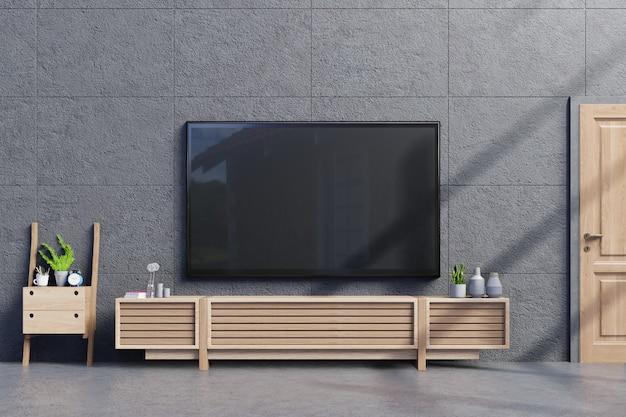 Tv na szafce w nowoczesnym pustym pokoju z betonową ścianą i podłogą