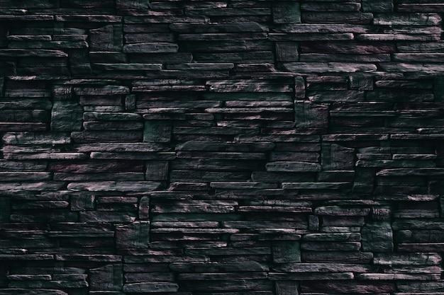 Twarda skała granitowa ściana starożytna ciemnozielona kamienna zewnętrzna tekstura powierzchni tła