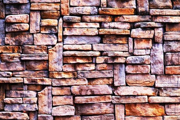 Twardy granitowy mur starożytny kamień zewnętrzna tekstura powierzchni tła