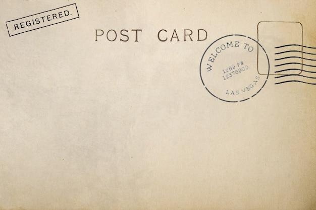 Tył pocztówki z brudną plamą