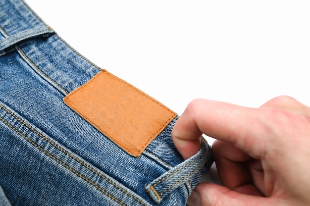 Tylna etykieta na dżinsach, z bliska. wysokiej jakości zdjęcie