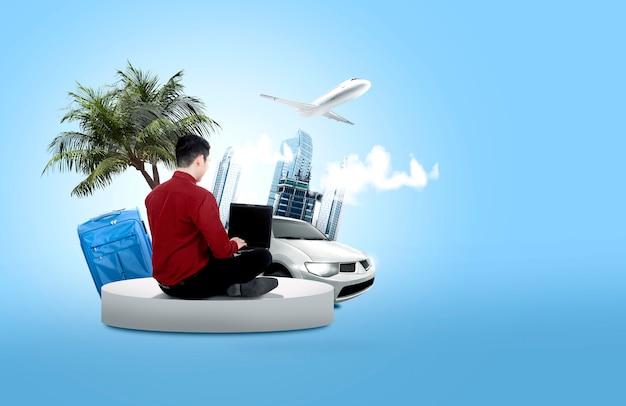 Tylni widok azjatycki biznesmen używa laptop robić podróżnemu rozkładowi dla wakacje