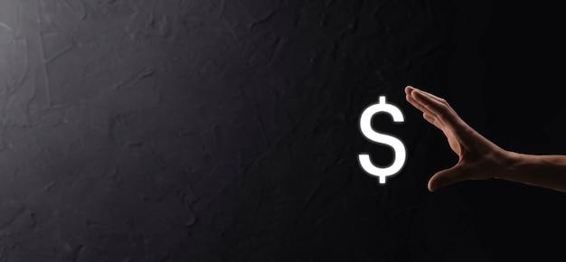 Udana koncepcja międzynarodowego symbolu finansowego sinvestment z biznesmenem mężczyzna osoba trzymająca pokazująca wzrost, wykresy i znak dolara, technologia cyfrowa