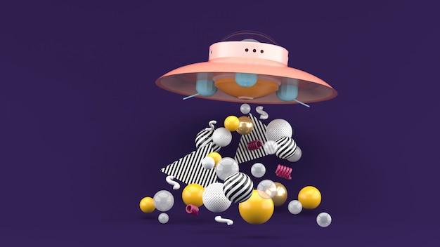 Ufo wśród kolorowych kulek na fioletowej przestrzeni