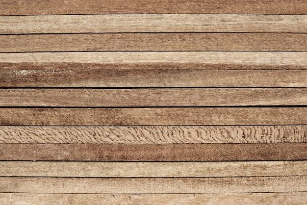 Ułożone drewniane deski teksturowanej tło projektu