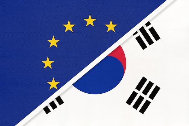 Unia europejska lub ue i korea południowa lub flaga narodowa z tekstyliów.