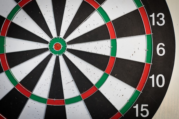 Used dart board with holes