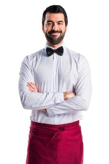Usługi przystojny kelner mężczyzna kokarda