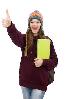 Uśmiechnięty uczeń z plecakiem i książką odizolowywającymi na bielu