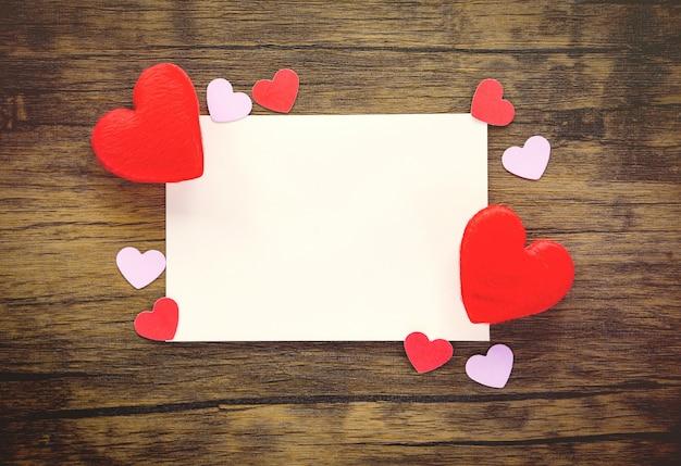 Valentines day card on wooden karta z zaproszeniem wedding red heart love