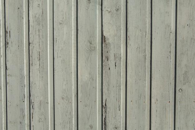 Vintage biała drewniana tekstura tła z sękami i otworami na gwoździe