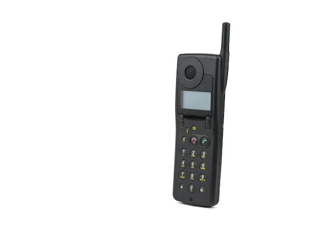 Vintage czarny telefon komórkowy na białym tle. retro środki komunikacji. technologia z przeszłości.