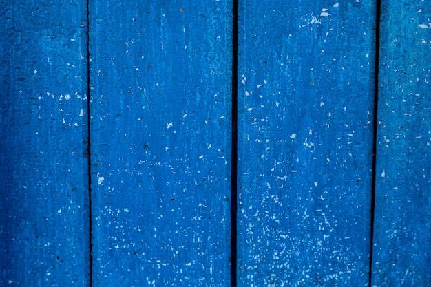 Vintage drewniane ciemnoniebieskie pionowe deski. widok z przodu z miejsca na kopię. tło dla projektu