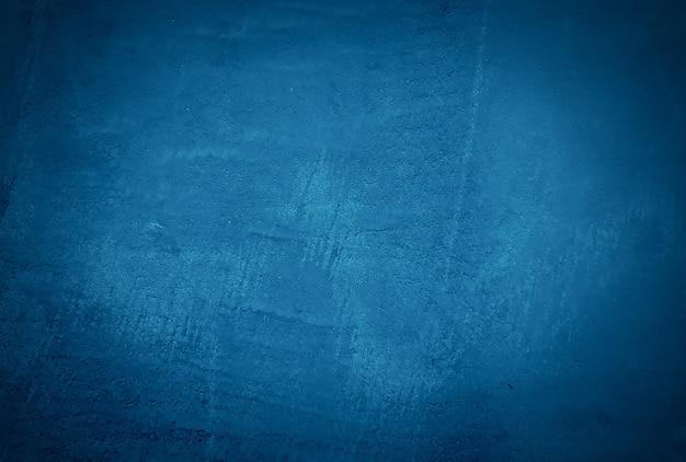 Vintage grunge niebieski beton tekstura tło ściany z winiety.