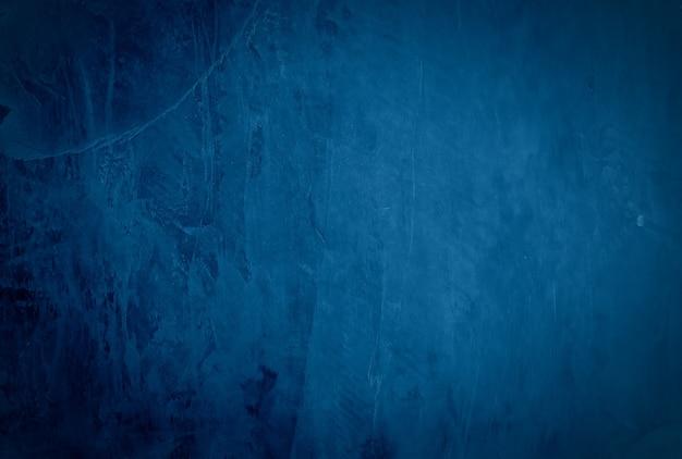 Vintage grunge niebieski tekstury betonu studio ściany tło z winietą.