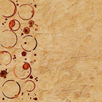 Vintage grunge tekstury papieru ze śladami filiżanek kawy i plamami kawy na powierzchni
