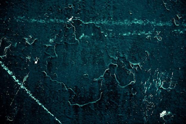 Vintage lazurowe tło. szorstka, pomalowana ściana w kolorze turkusowym. niedoskonały samolot w kolorze cyjanu. nierówne stare ozdobne stonowane tło o akwarelowym odcieniu. tekstura odcień turkusowy. ozdobna, kamienista powierzchnia.