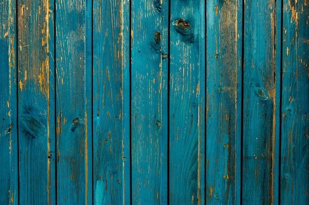 Vintage niebieski tekstury tła drewna z węzłami i otworami na gwoździe