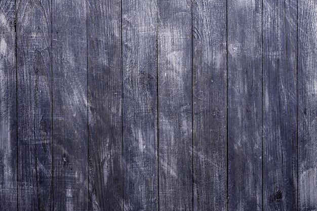 Vintage niebieskie tło tekstury drewna z węzłami i otworami na gwoździe