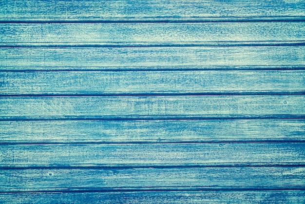 Vintage niebieskim tle drewna