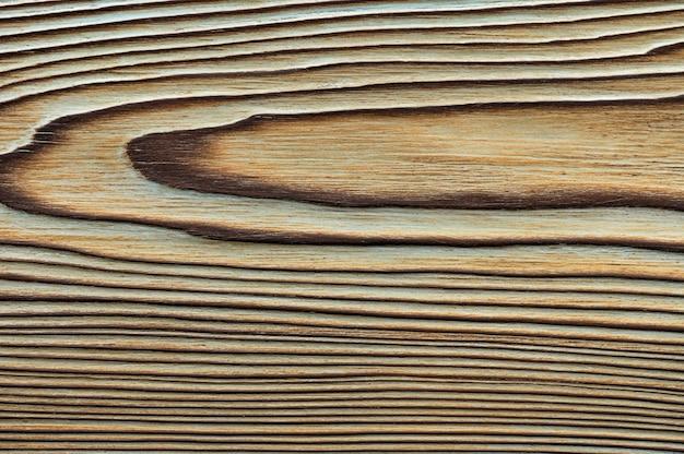 Vintage tekstura drewna z sękami. widok z góry zbliżenie na tło lub dzieła sztuki.