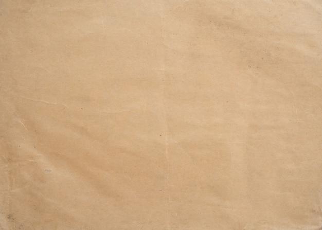 Vintage to zmięty papier brązowy. tekstura tło
