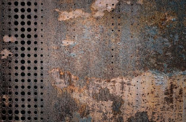 Vintage zardzewiały grunge stali udekorować przez wiercenie ściany teksturą tle