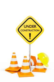 W budowie pachołków drogowych i znak z kaskiem