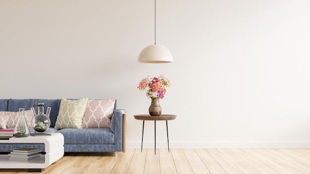 W pustym salonie znajduje się niebieska sofa. wazon ozdobnych kwiatów na stole z pustą białą ścianą. renderowania 3d