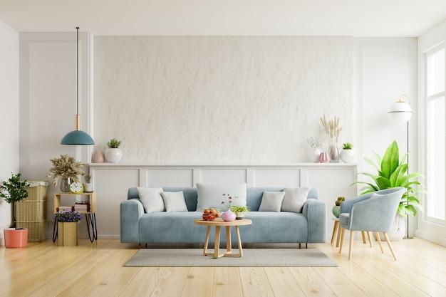 W salonie z białym tynkiem znajduje się sofa i fotel.