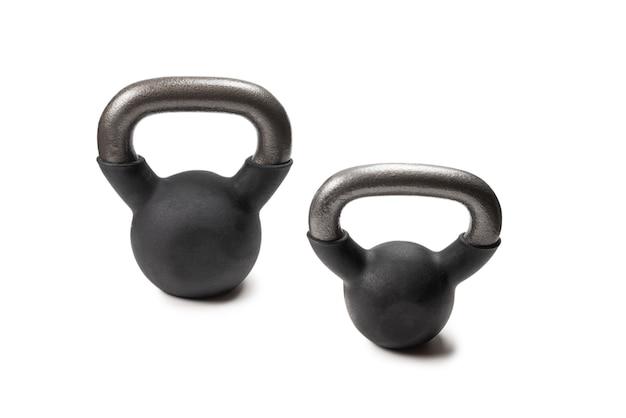 Waga czarny na białym tle. waga 4 kg. fitness dla kobiet.