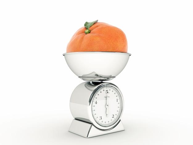 Waga kuchenna z gigantyczną mandarynką