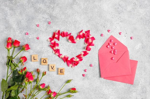 Walentynki kartkę z życzeniami z kwiatami róży.